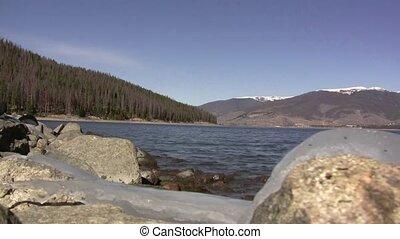 Mountain Lake Rocky Shore Waves - Lake wakes pound this...