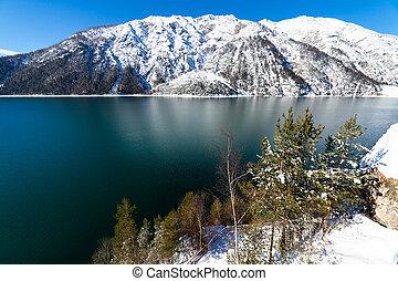 Mountain lake snow landscape