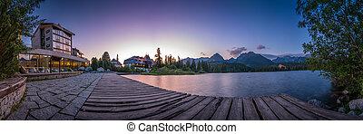 Mountain lake Strbske pleso in National Park High Tatras at sunrise