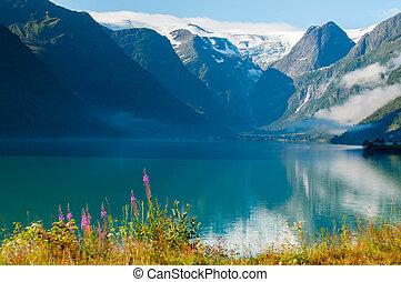 Mountain lake sunrise in Norway