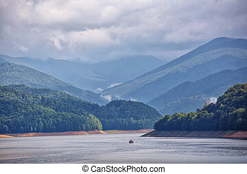 Mountain lake. The lake between the rocks.