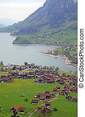 mountain lake village in the Alps, Switzerland .