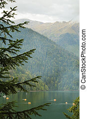 mountain lake with catamarans