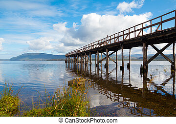 Mountain lake with wooden pier