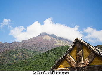 Mountain landscape and wooden cabin