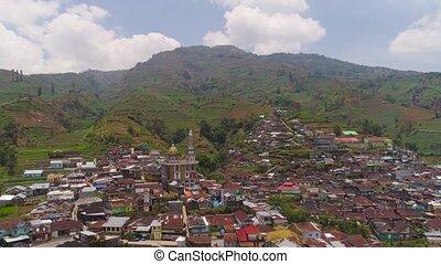 Mountain landscape farmlands and village Java Indonesia -...