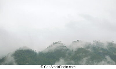 Mountain Landscape Full of Slow Clouds - Peak of the...