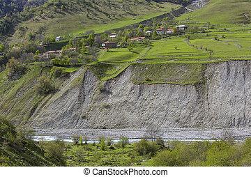 Mountain landscape in Georgia Kaukaz with beautiful sky