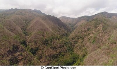aerial view slopes mountains covered with forest and vegetation. mountain hilly landscape in asia. tropical landscape