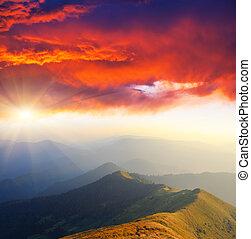 Majestic sunset in the mountains landscape. Overcast sky before storm. Carpathian, Ukraine, Europe.