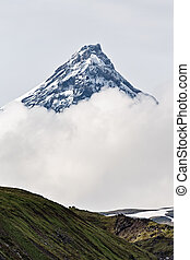 Mountain landscape of Kamchatka: Kamen Volcano in clouds