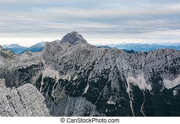 Mountain landscape of sheer ridge above valley. Mangart,...