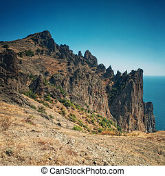 mountain landscape with blue sky and sea