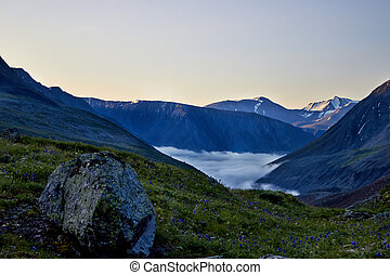 Mountain landscape with fog in the valley