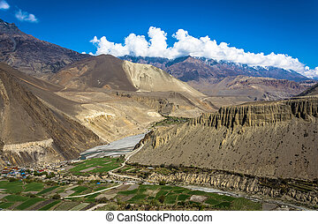 Mountain landscape with Nepalese village. - Mountain...