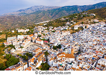 Mountain landscape with Spanish town of Competa on slopes