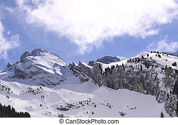 mountain massif in winter big rocks