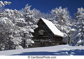 Mountain house in snow, winter sunny day