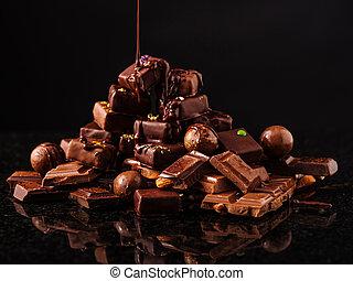 Mountain of chocolate and chocolates candys. - Mountain of...
