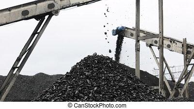 mountain of coal, coal falls from the conveyor - Conveyor...