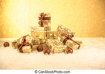 mountain of gifts with golden Christmas decorations