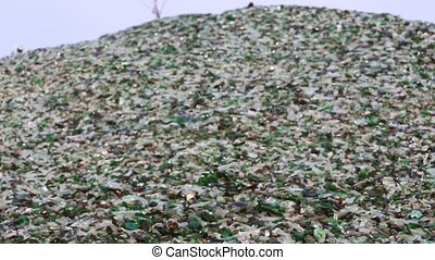 Glass broken bottles in recycling industry factory -...