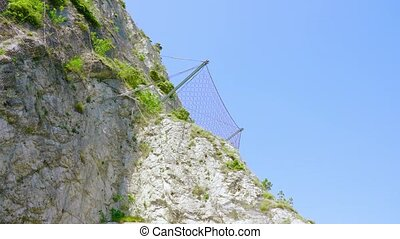 Rock mountain with rockfall protection wire mesh