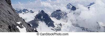 Mountain panorama at the Mount Titlis - Mountain world at...