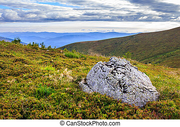 mountain panorama with large rock on the hillside - panorama...