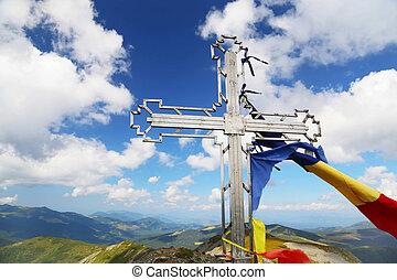 Mountain peak cross in Calimani Mountains, Vf.Pietrosu, Romania