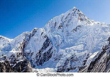 Mountain peak in Himalayas, Nuptse - Mountains landscape in ...