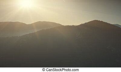Mountain peak range sunrise soft light aerial view -...