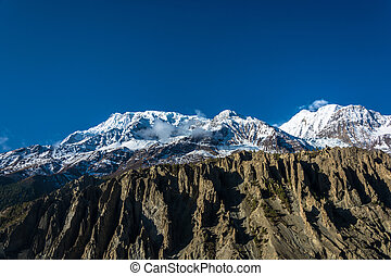 Mountain peaks in snow and clouds, Nepal. - Beautiful snowy...