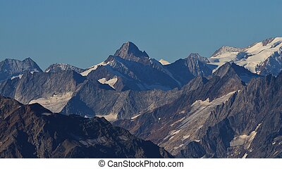 Mountain peaks of the Swiss Alps in summer