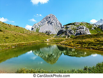Mountain pond. Mountain reflection in the Lake
