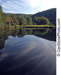 Mountain Pond - The morning sky reflected in a mountain pond...