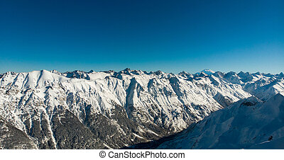 mountain range covered with snow on a Sunny day