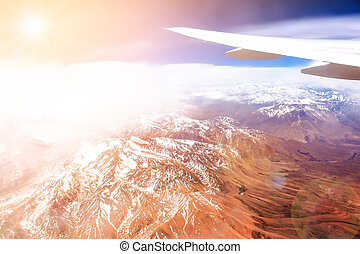 Mountain range form the airplane - View from the airplane to...