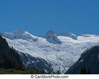 Mountain range snow capped and clear blue sky