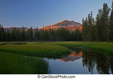 Mountain reflections - Sunset in the Sierra Mountains in the...