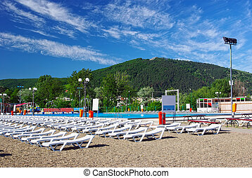 Mountain resort: swimming pool and chaise lounges.