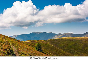 mountain ridge behind the rolling hills under the blue sky...