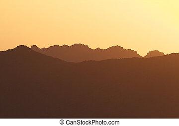 Mountain Ridges in Sunset
