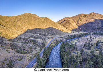 mountain river aerial view in sunset light