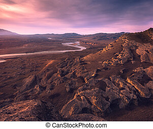 Mountain river at the colorful sunset