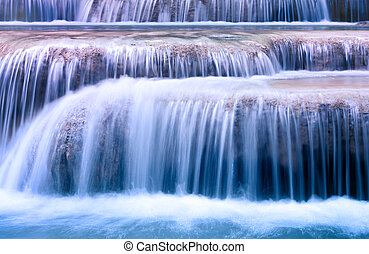 Mountain river background with small waterfalls