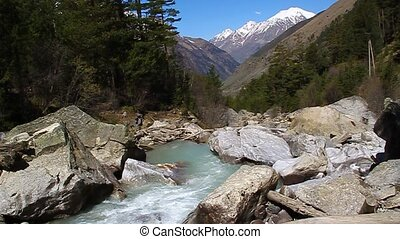 Mountain river flowing in the valle