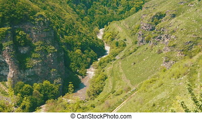 Mountain River Flows into the Gorge Canyon of the Mountains...