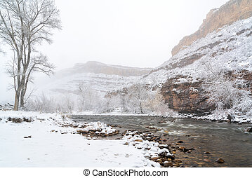 mountain river in a heavy April snowstorm