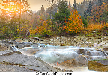 mountain river in autumn at sunset